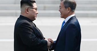 North Korean leader Kim Jong-un's handshake with South Korean leader Moon Jae-in.