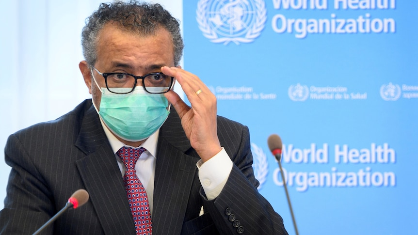 TedrosAdhanom Ghebreyesus wearing a surgical mask while appearing at a press conference.