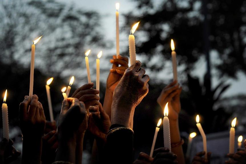 Candles held during a vigil in Kolkata, India, for a gang-rape victim.