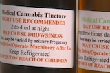 Labels on two vials of medicinal cannabis.