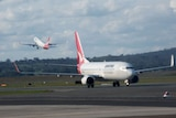 Qantas planes on the tarmac at Canberra Airport.