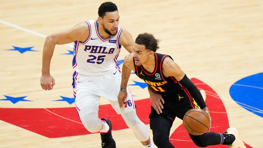 Philadelphia 76ers player Ben Simmons chases Atlanta Hawks guard Trae Young during an NBA playoffs game.
