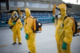 Brazilian workers spray chemicals to kill mosquitoes in Rio de Janeiro