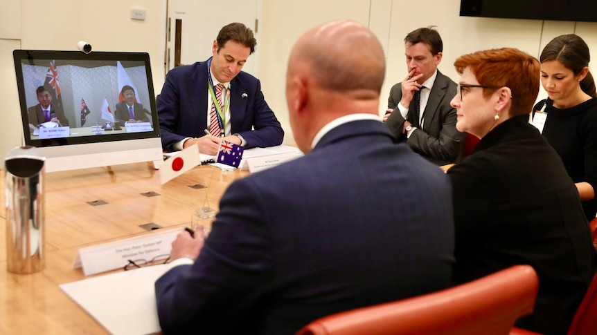 Marise Payne and Peter Dutton on video conferencing with Japanese counterparts.