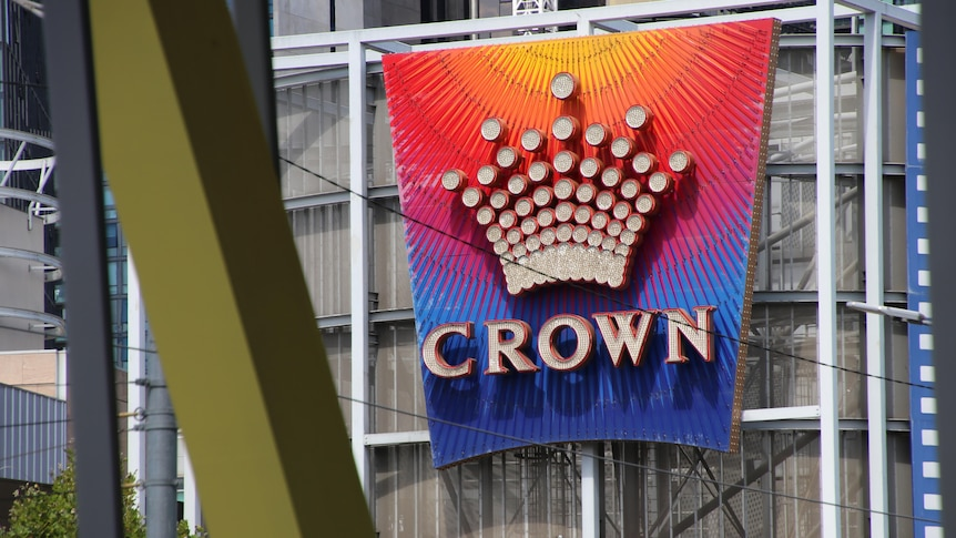 The Crown casino logo is emblazoned on a colourful sign.