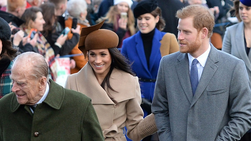 Prince Philip, Prince Harry and Meghan Markle arrive for the Royal Family's Christmas Day service.