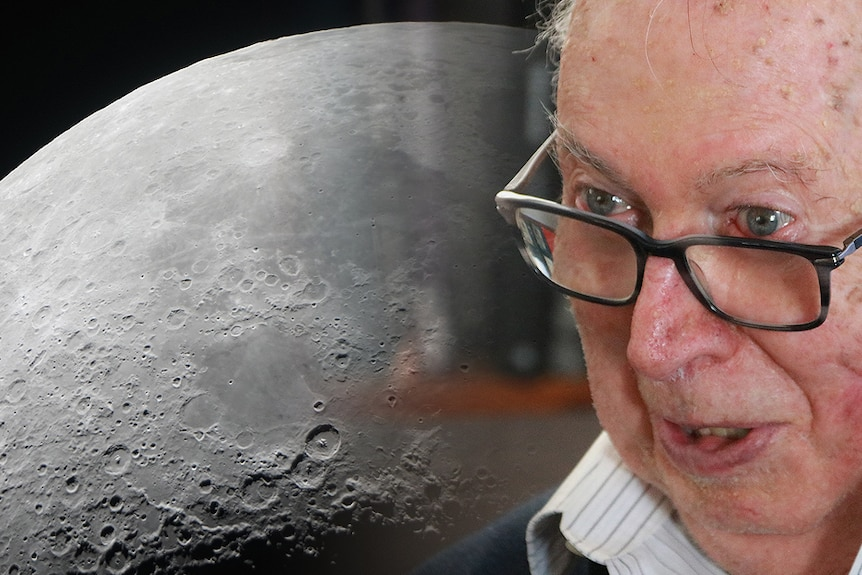 An old man next to a close-up photo of the moon.