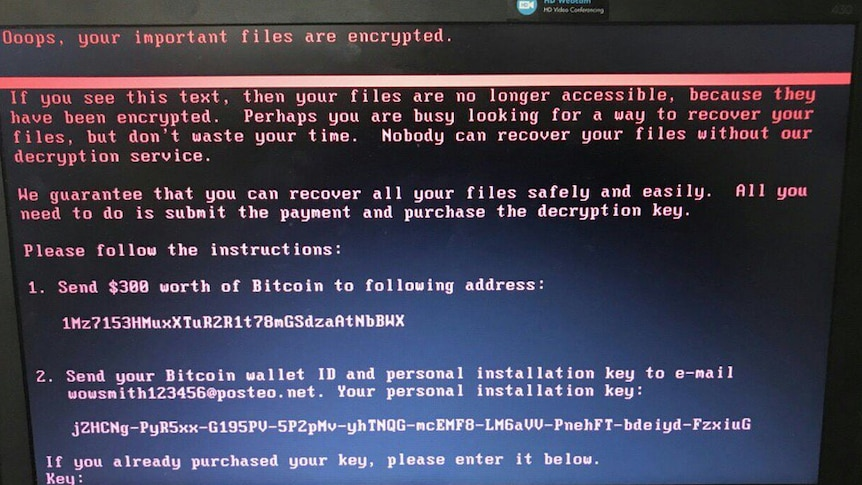 A close-up of a computer screen shows an ominous message from hackers demanding Bitcoin
