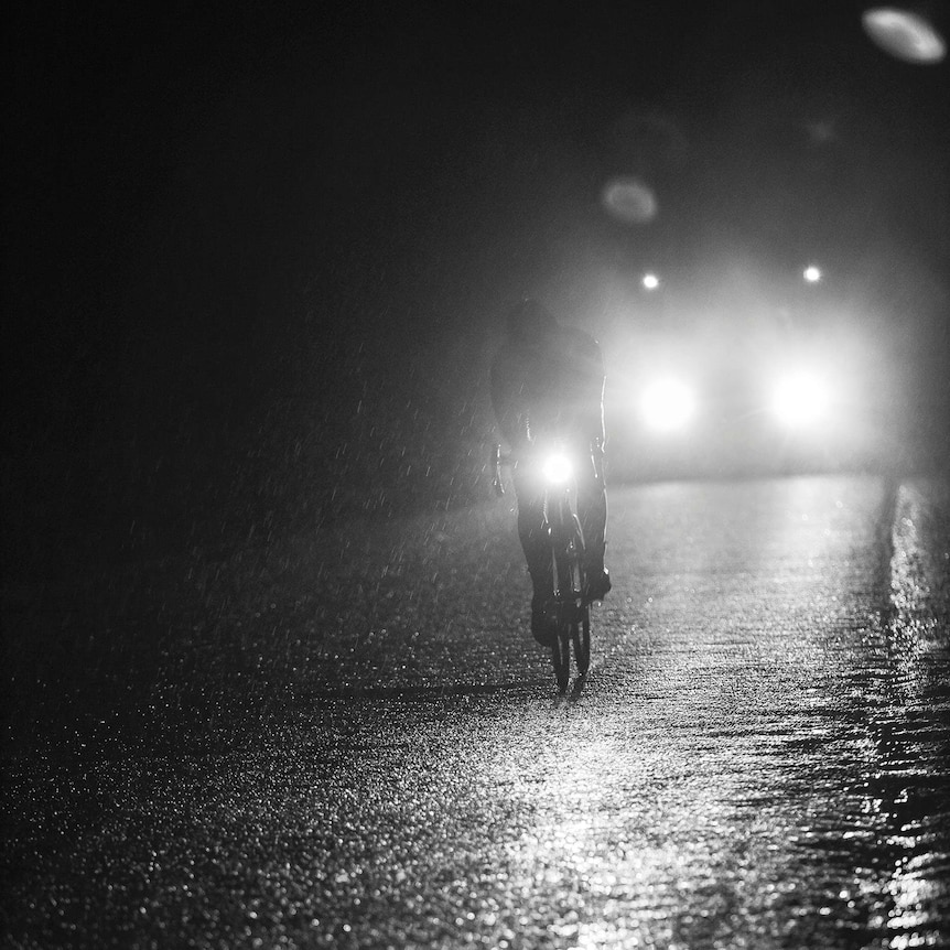 Mark Beaumont rides at night in the rain