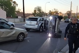 The vehicles collided, causing the autonomous vehicle to roll onto its side.