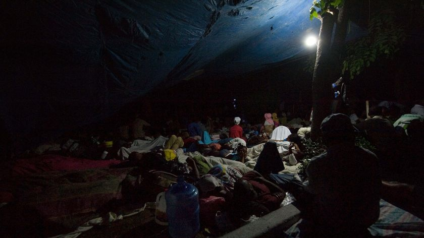 People sleep on a square in Port-au-Prince's Petionville district