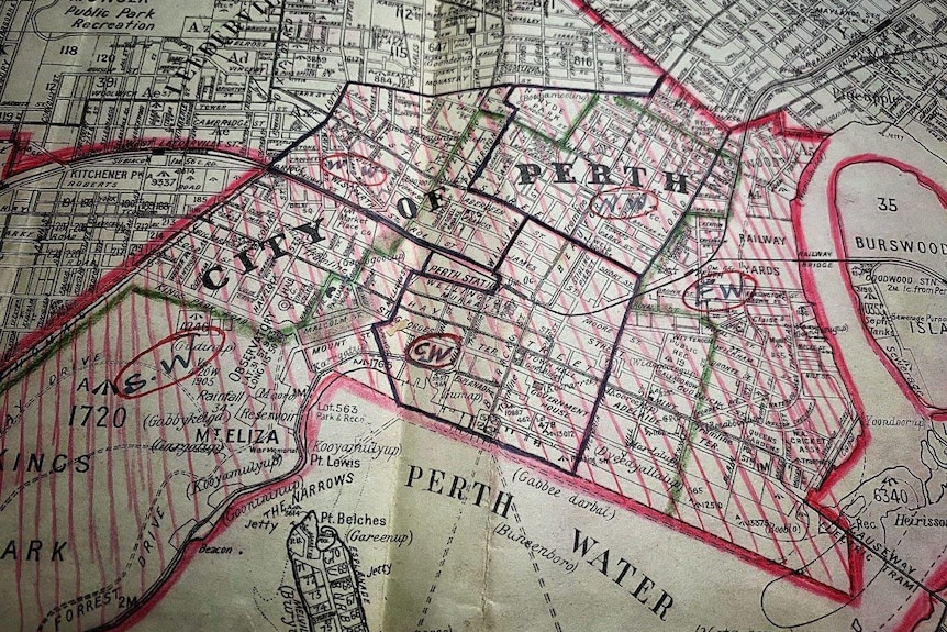 Historical map of Perth with areas marked in red.