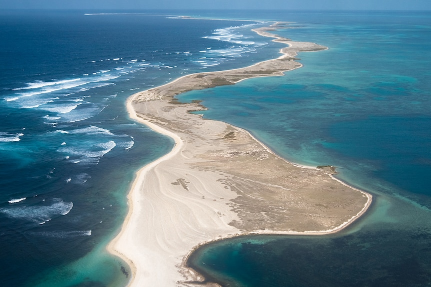 An aerial view of a remote sandy island.
