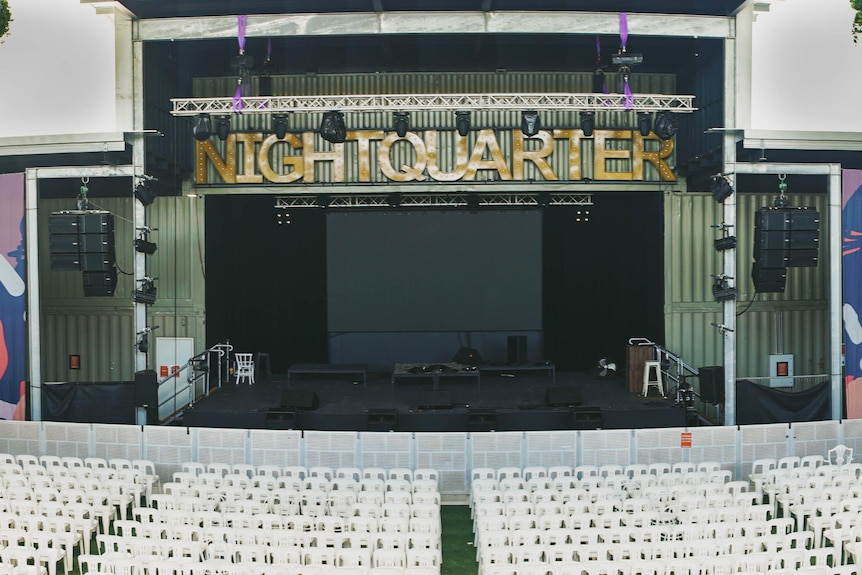 An empty concert venue with stage.