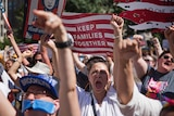 Activists shout during the rally to protest the Trump administration's immigration policies