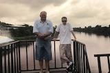 Bill and Jozef Stefaniak pose for a picture on a bridge.