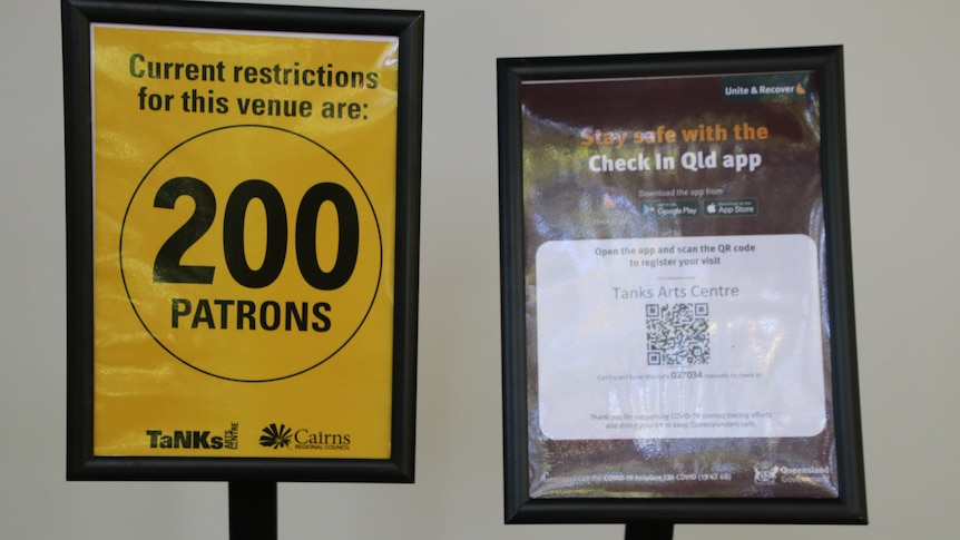 a sign showing 200 patrons and a COVID QR code check in
