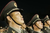 China's People's Liberation Army troops stand to attention
