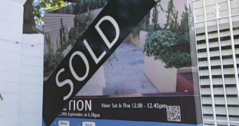 Real estate board with Sold sign