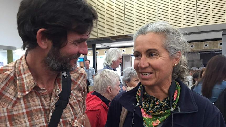 Madeleine Habib at airport with husband Stuart Baird