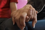 Illegal love: two sex workers hold hands in Adelaide