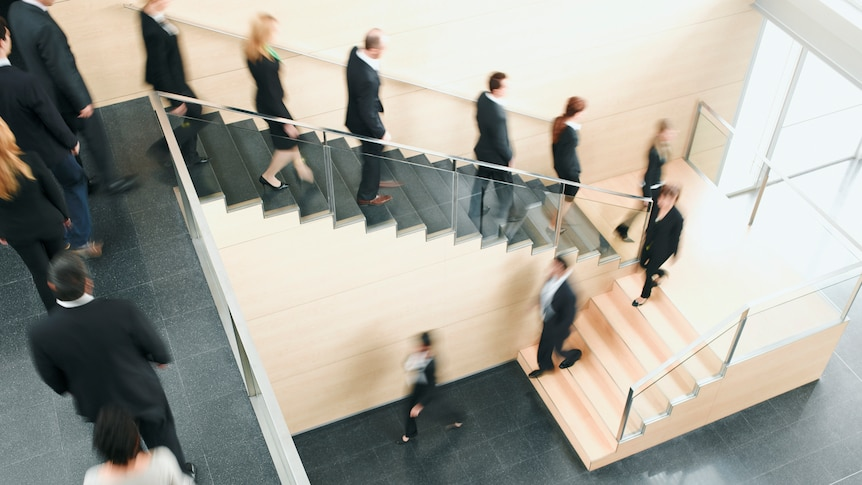A stream of people exiting the office