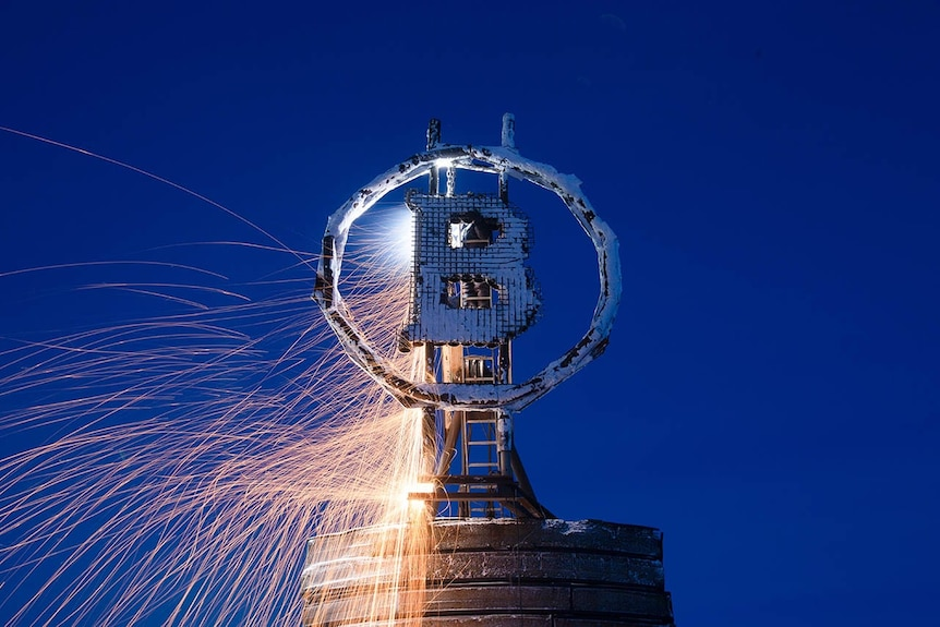 Bitcoin sculpture with sparks
