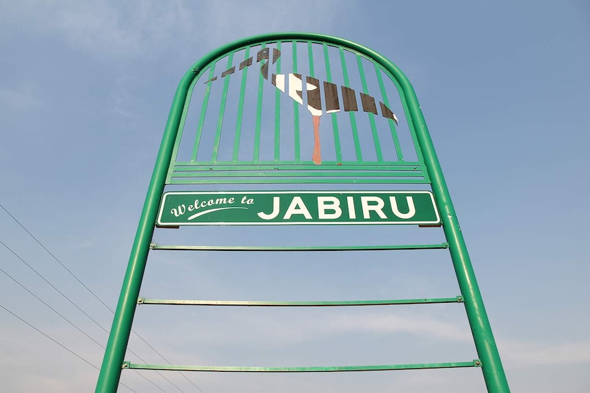 A low angle photo of the Jabiru sign at the entrance to the town.