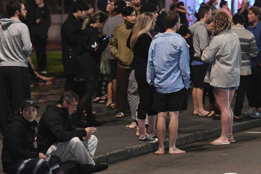 A group of people gather on the street after a strong quake in the Cheviot area of New Zealand.