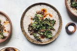 Three bowls of brown rice congee with a side of sea salt.