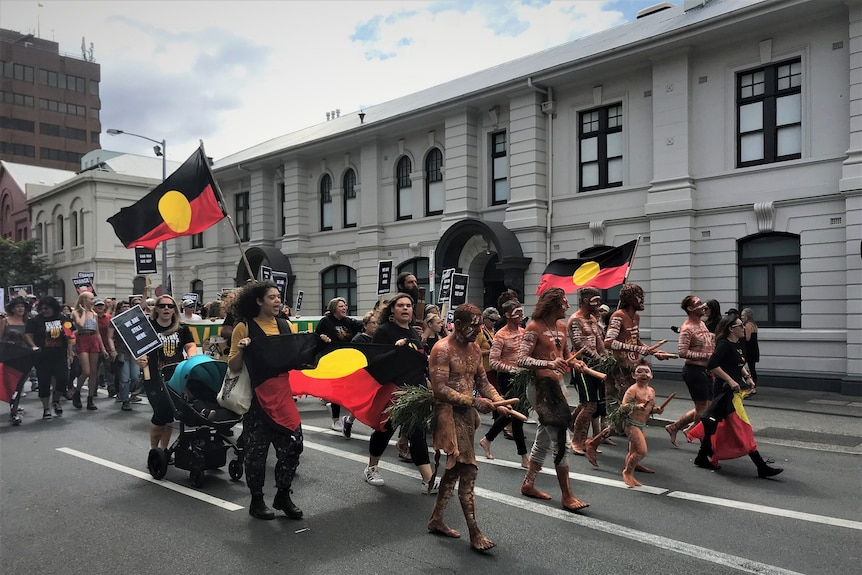 Protesters in an Invasion Day rally in Hobart.