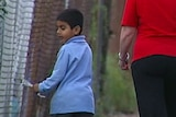 Sharthi visits his father with refugee advocate Alison Sloan at the Villawood Detention Centre.