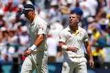 Australia's David Warner talks with England's Tom Curran on day one at MCG on December 26, 2017.