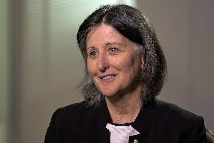 Fiona Guthrie wears a black jacket over a white top.