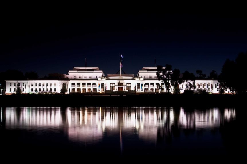 Old Parliament House and its reflection in water.
