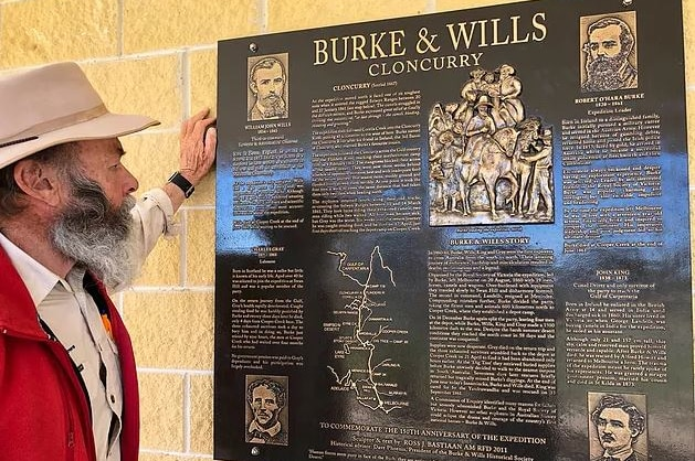 Phil McDonald reads an interpretive panel about the Burke and Wills expedition in Cloncurry.