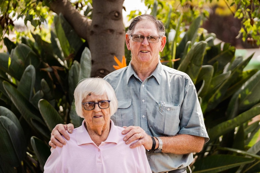 Kay and Bob Lockley standing together in their garden.