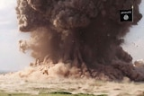 A cloud of dust following Nimrud being blown up by Islamic State
