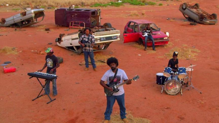 Warralong man Willy Kickett with his band Karntimarta