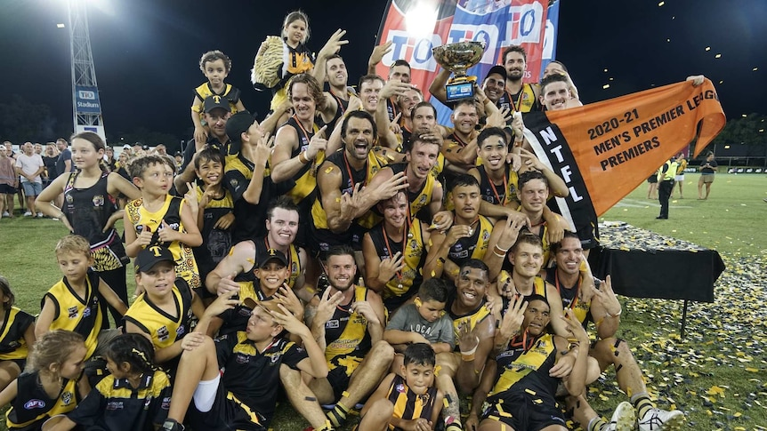 Nightcliff Tigers celebrate with the premiership cup after winning the 2020/21 NTFL grand final.