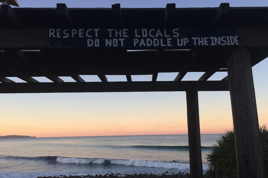 A sign imploring visitors to the Lennox Head point surf break to 'respect the locals, do not paddle up the inside'.