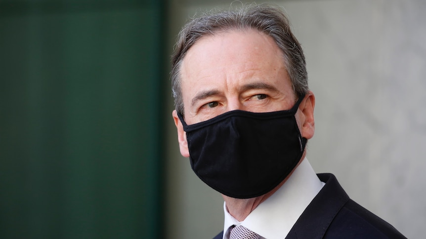 Close up of Hunt, eyes darting across over his black mask.