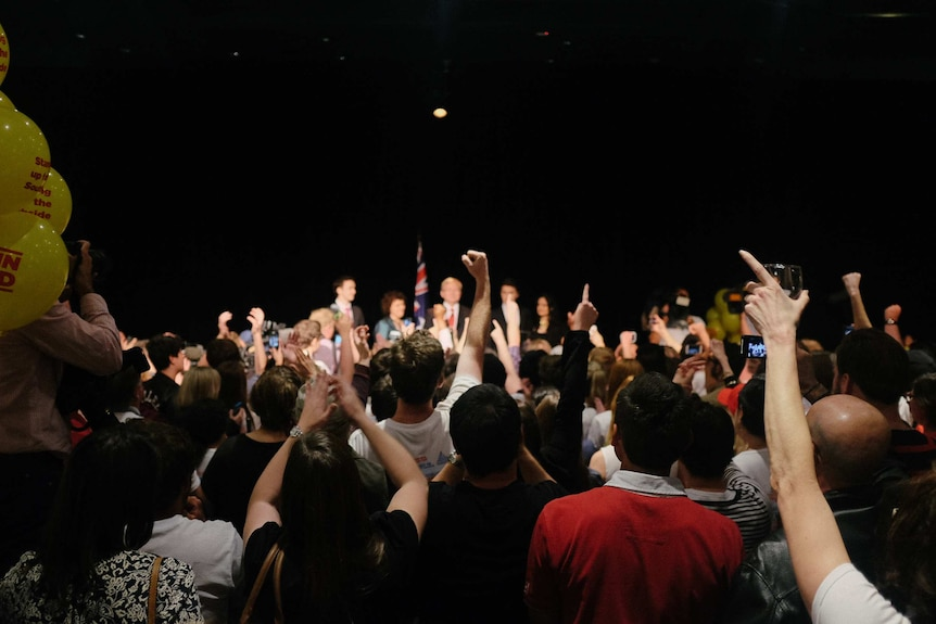 The crowd cheers for Kevin Rudd during his concession speech.