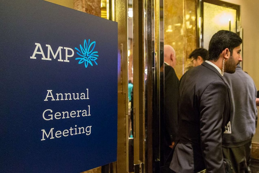 AMP shareholders walk past AGM sign, Melbourne Grand Hyatt