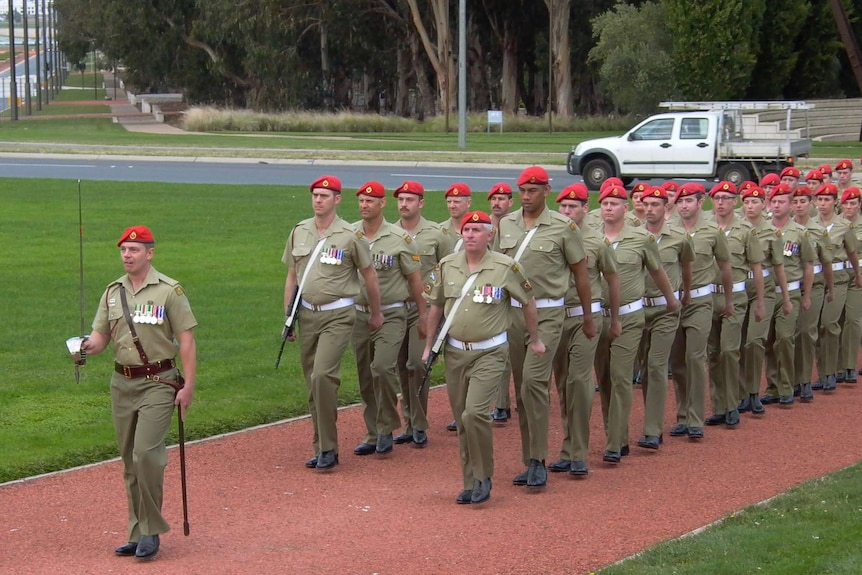 Members of the Military Police march in front of the Australian War Memorial.
