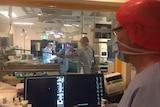Surgeons performing heart surgery