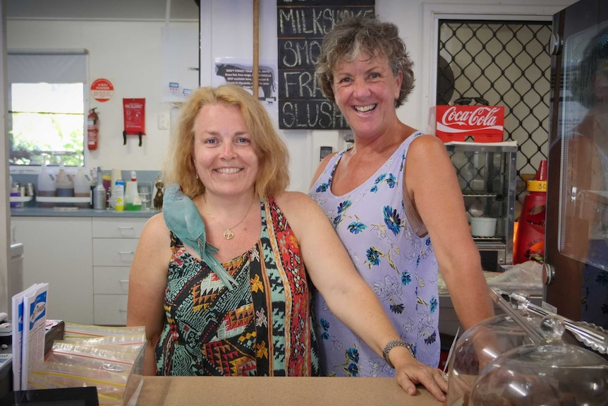 Eungella General Store owner Michaela Pritchard (left) and colleague standing behind the counter.