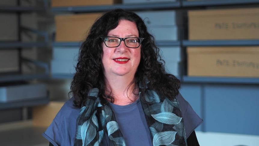 Space archaeologist Dr Alice Gorman wearing black-framed glasses