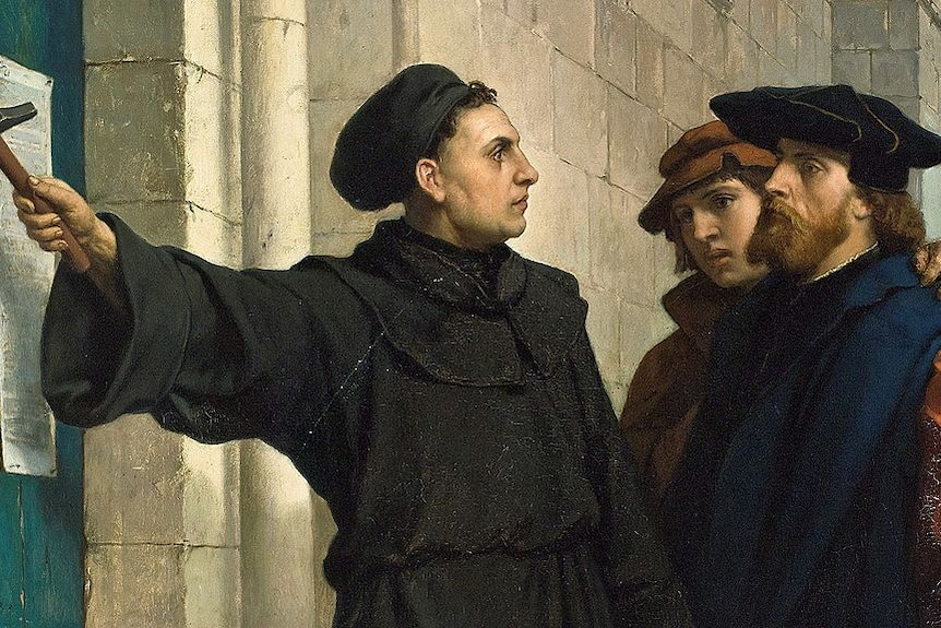 Painting of Martin Luther nailing his Ninety-five Theses to a church door.