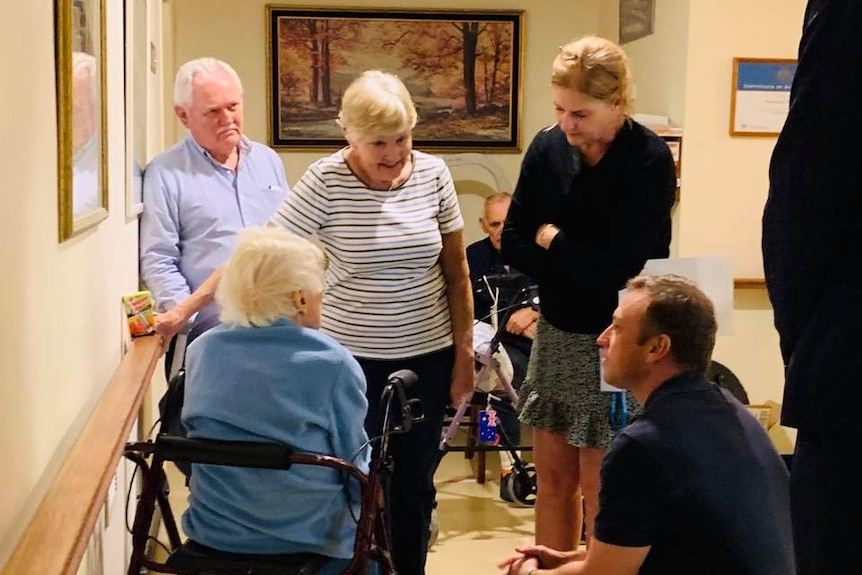 Mr Miles with residents at the retirement village.
